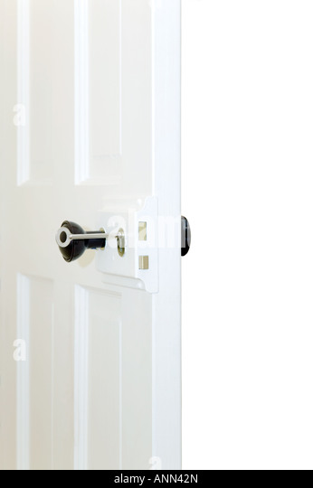 Old fashioned door with key in lock open - Stock-Bilder