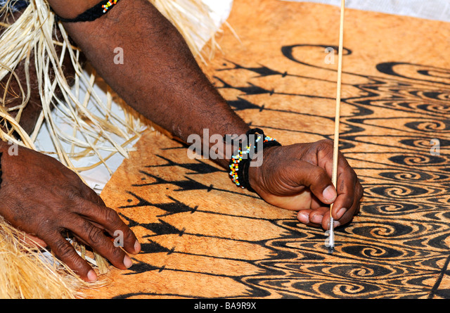 Bark painting, local artist paints traditional motifs on the bark of the Khambouw tree, Lake Sentani area, West - Stock Image