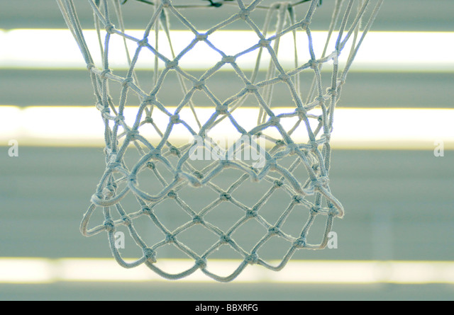 Royalty free photograph of basketball netball net hanging in sports hall. london UK - Stock Image