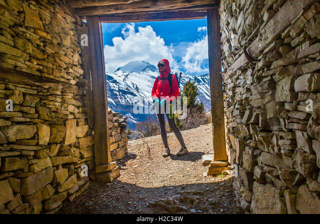 Photo Beautiful Woman Traveler Backpacker Mountains Way.Young Girl Looking Away Take Rest Sunny Terrace.Snow Landscape - Stock Image