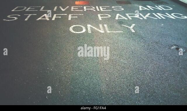 High Angle View Of Text On Street - Stock-Bilder