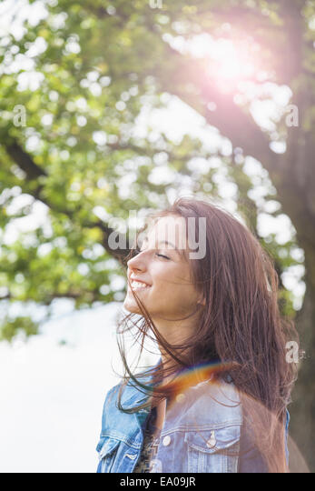 Teenager enjoying breeze - Stock Image