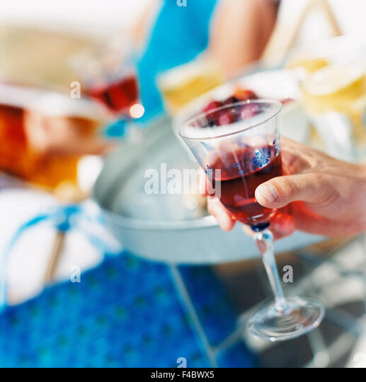body part part of close-up color image drink drinking glass food and drink glass human hand part of party square - Stock-Bilder