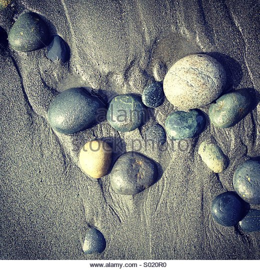 Pebbles on beach, Vancouver Island, Canada - Stock Image