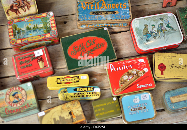 Colourful old tin boxes on a market stall, Portobello Road, Notting Hill, London, UK. - Stock Image