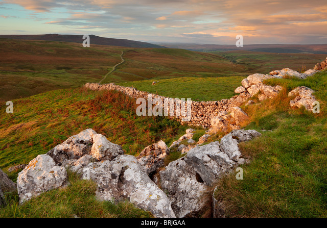 Morning view of Simon's Seat and Wharfedale as seen from atop Nursery Knot near Stump's Cross Caverns in - Stock Image