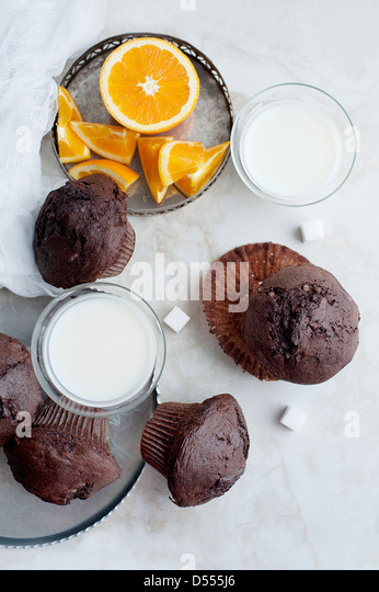 Chocolate muffins with milk and orange - Stock Image