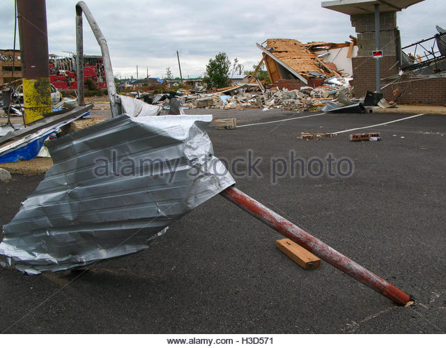 Steel siding from a local business became wrapped around a sign post during an EF-4 tornado. - Stock Image