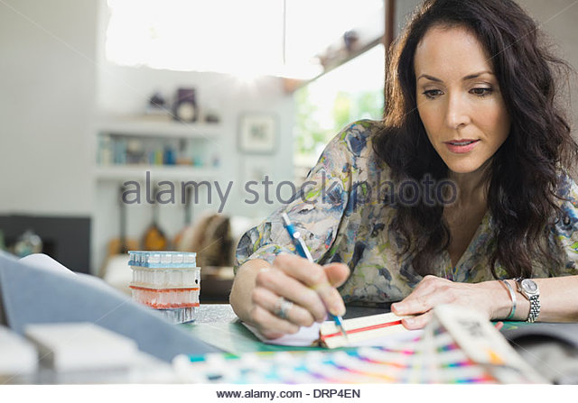 Interior designer working in home office - Stock Image