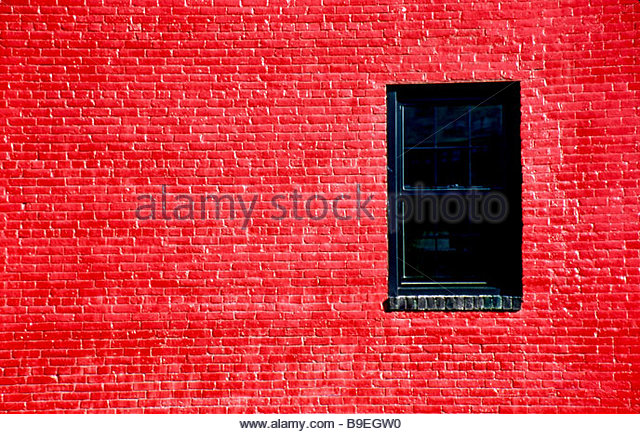 Bright red painted brick wall with window - Stock-Bilder