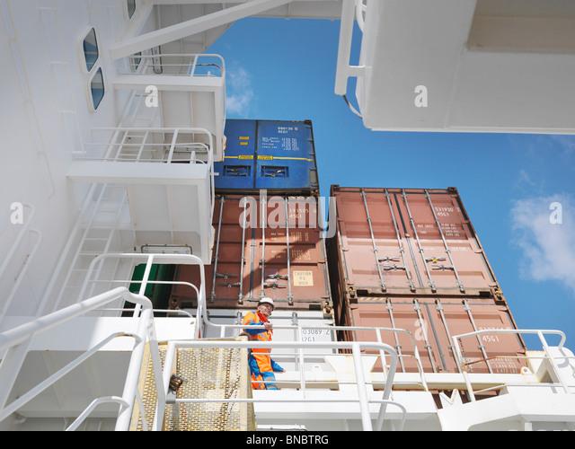 Sailor waking in cargo area - Stock-Bilder