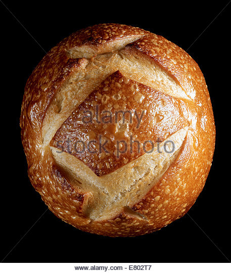 Old Fashion baked bread loaf on black background - Stock Image