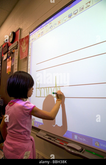 Kindergarten students use an interactive whiteboard in the classroom of a public school in Boise Idaho USA MR - Stock Image
