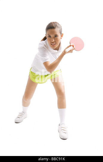 Young woman playing table tennis - Stock Image