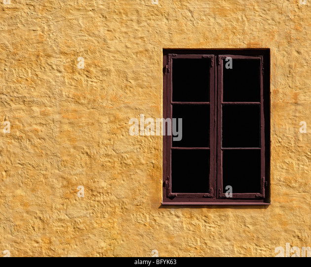 Window and yellow wall - Stock Image