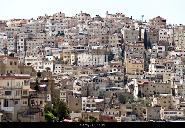 A view of residential homes perched on a hill in downtown Amman, in the Hashemite Kingdom of Jordan. - Stock Image