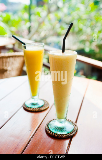 Mango fruit juice at breakfast in a cafe in Ubud, Bali, Indonesia, Southeast Asia, Asia - Stock Image
