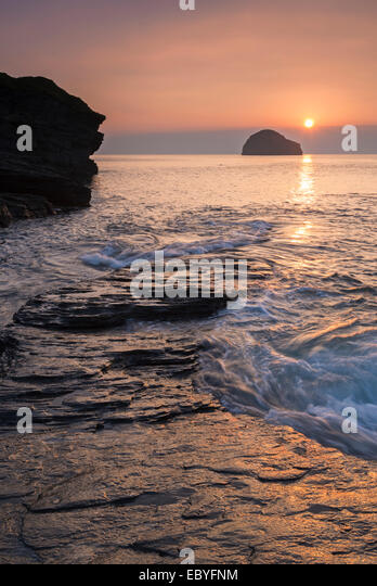 Sunset over Trebarwith Strand beach in North Cornwall, England. Autumn (September) 2014. - Stock Image