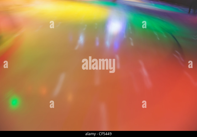 Multi-coloured blured abstract skating rink in movement - Stock Image