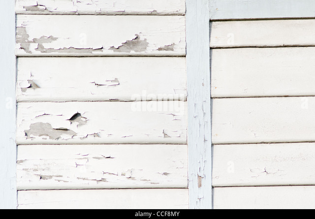 wooden wall with peeling white paint. - Stock-Bilder