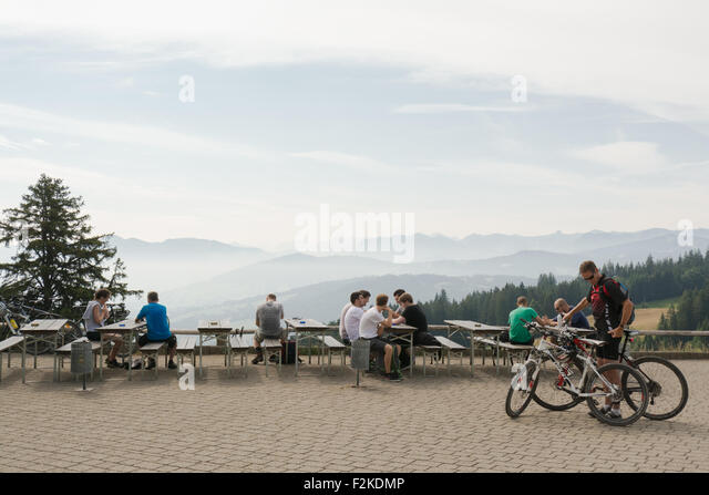 Alpine peaks viewed through layers of mist from a viewing platform on the Pfaender mountain, Bregenz, Austria - Stock Image