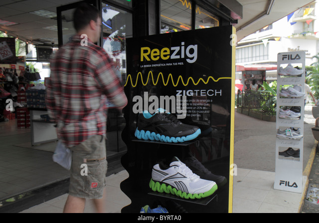 Panama City Panama Bella Vista Via Espana business shoe store storefront sidewalk product display athletic shoes - Stock Image
