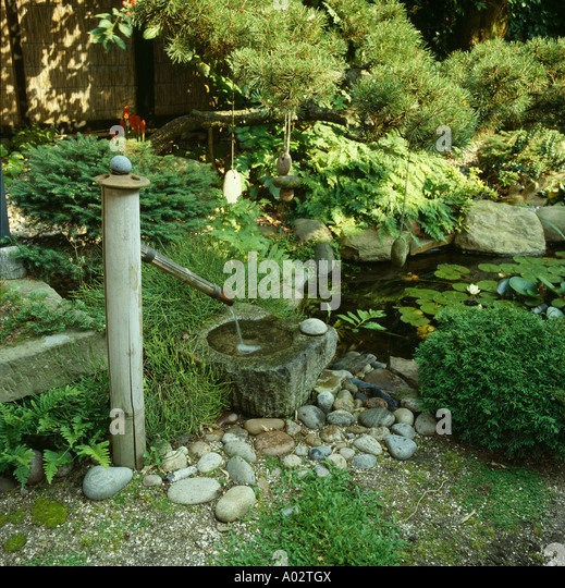 Bamboo water fountain stock photos bamboo water fountain for Japanese bamboo water feature