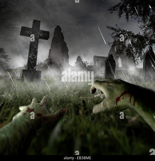 Zombie hands on graveyard - Stock Image