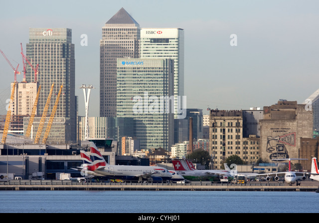 Regional airliners at London City Airport. Canary Wharf and O2 in the background, England, UK - Stock Image