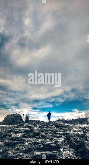 man,walking,art,mountains,nature,wild - Stock Image