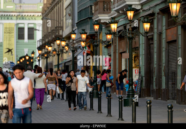 Pedestrian in the pedestrian zone Jirón Carabaya with historic streetlamps, Lima, Peru - Stock Image