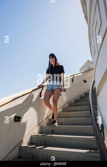 Young woman moving down stairway at Griffith Observatory, Los Angeles, California, USA - Stock-Bilder