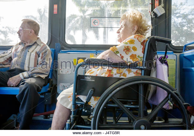 Miami Florida Metrobus mass transit public transportation passenger wheelchair ADA accessible woman man senior disabled - Stock Image