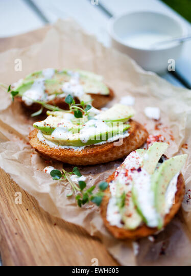 Avocado toast with cream cheese and chili - Stock Image