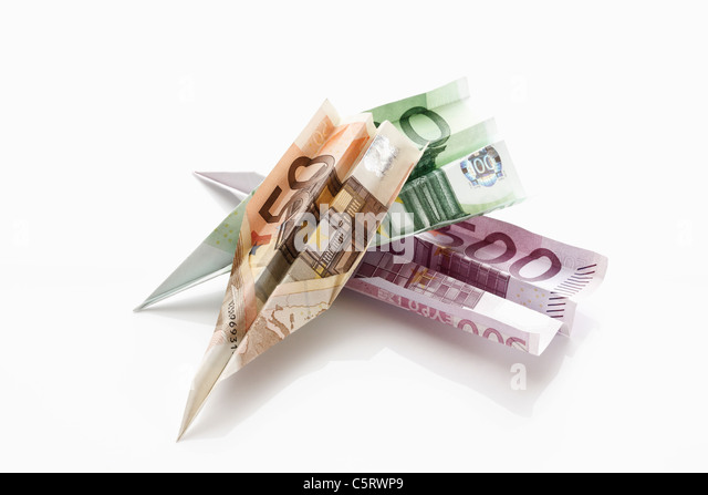 Paper aeroplanes folded from Euro banknotes - Stock Image