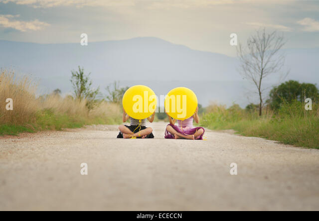 Two girls (6-7, 8-9) with balloons - Stock Image