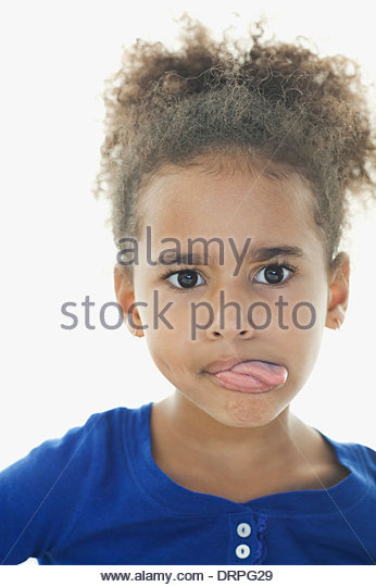 Close-up of girl sticking tongue out - Stock Image