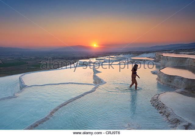 Pamukkale - limestone terraces at sunset, Pamukkale, Turkey - Stock Image