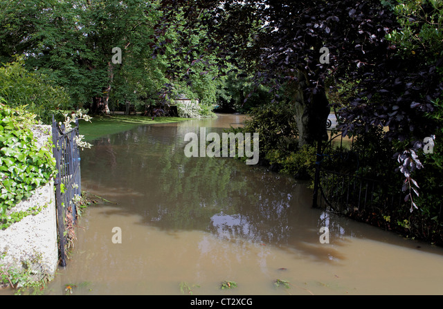 Local garden in Weymouth, Dorset gets flooded during worst summer weather in over 50 years. - Stock Image