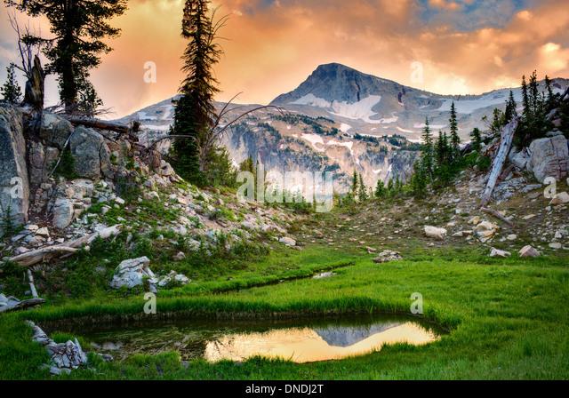 Small pond reflecting Eagle Cap Mountain. Eagle Cap wilderness, Oregon - Stock Image