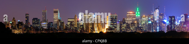 Panorama of midtown Manhattan at night in New York City along Central Park South - Stock Image