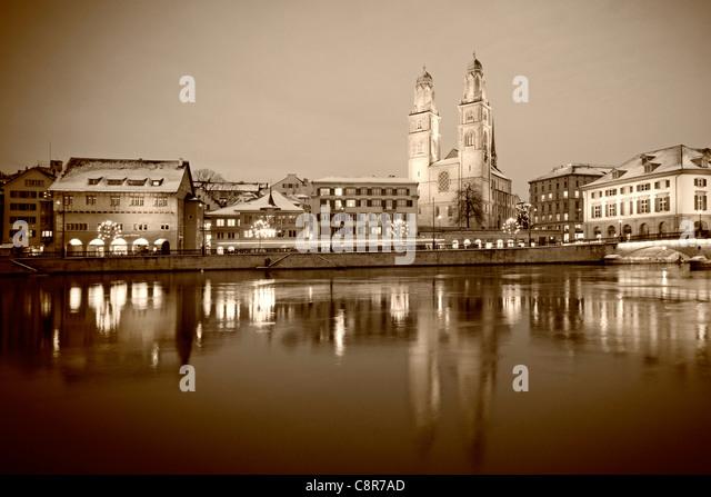 Grossmunster at river Limmat in Zurich, Switzerland - Stock Image
