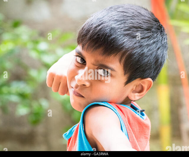 Kid showing emotions of Anger, hate, disgust and distress - Stock Image
