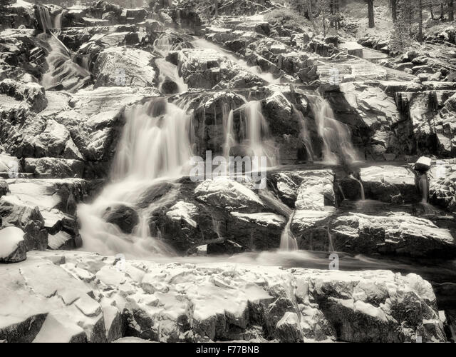 Glen Alpine Falls minutes after fresh snowfall. Lake Tahoe, California - Stock Image