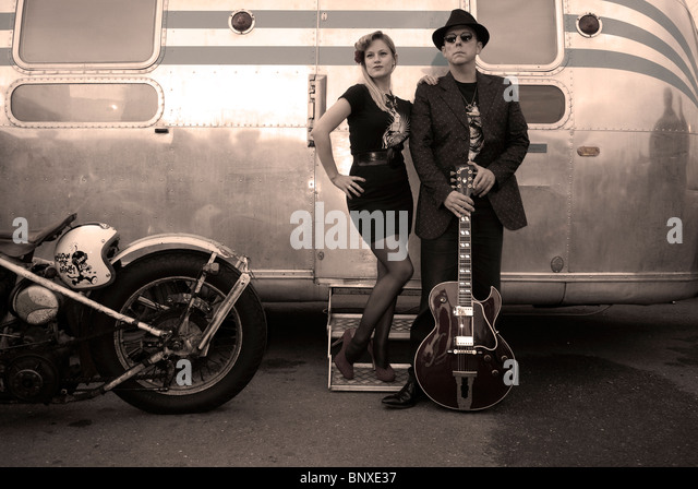 Hot Rod night at the Ace Cafe London UK musicians in 1950's dress. - Stock Image