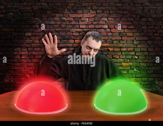 Man chooses right button over brick wall - Stock Image