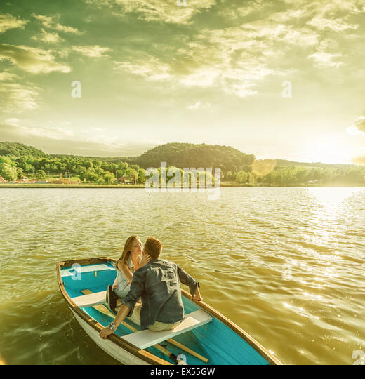 Couple in love on the boat - kissing - Stock-Bilder