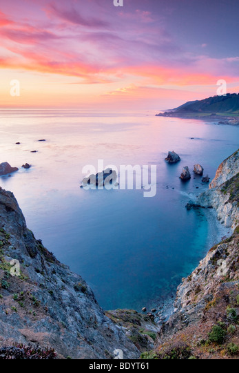 Sunset with offshore rocks. Big Sur coast. California - Stock Image