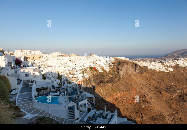 The beautiful town of Imerovigli on the cliff edge of the Greek island of Santorini. The white painted buildings - Stock Image