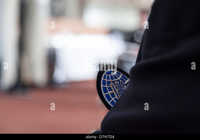 International weightlifting federation official wearing IWF badge on suit. - Stock Image